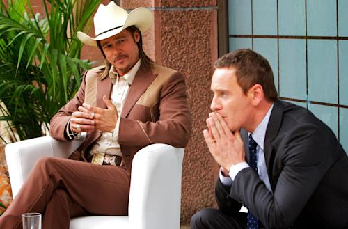 """This photo released by Twentieth Century Fox shows Brad Pitt, left, as Westray and Michael Fassbender as the Counselor, in the film, """"The Counselor."""" (AP Photo/Copyright Twentieth Century Fox, Kerry Brown)"""