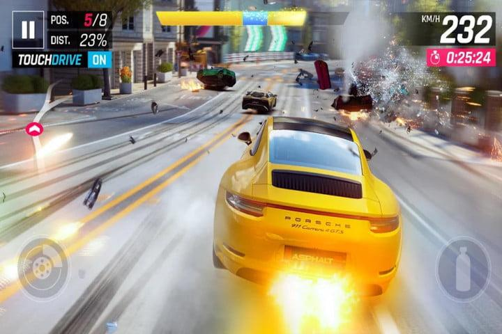 Screenshot of Asphalt 9: Legends game on Android showing a yello porsche racing