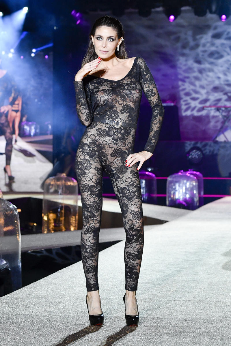 A model wears a sheer catsuit at Paris Fashion Week