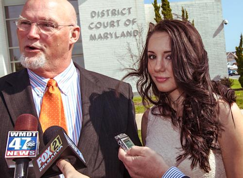 Melissa King stands with her attorney, J. Gregory Hannigan. outside the Ocean City, Md., Courthouse Monday, April 22, 2013, as he answers questions. King resigned as Miss Delaware Teen USA after an online porn video surfaced was given a year of probation Monday for underage alcohol possession in Maryland. (AP Photo/The Wilmington News-Journal, Robert Craig ) NO SALES THE NEWS JOURNAL/ROBERT CRAIG