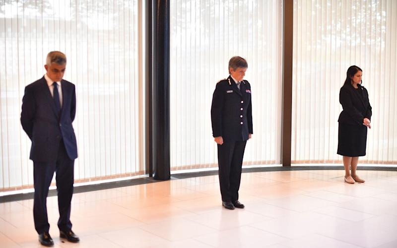Mayor of London Sadiq Khan, Metropolitan Police Commissioner Cressida Dick and Home Secretary Priti Patel observe a minute's silence inside the atrium at Scotland Yard - Victoria Jones/PA