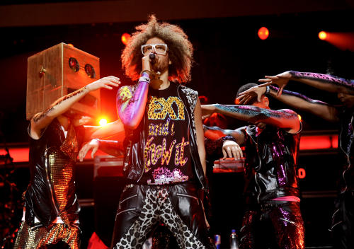 "FILE - In this Dec. 9, 2011 file photo, singer RedFoo, center, and LMFAO perform at Z100's Jingle Ball concert at Madison Square Garden in New York. When LMFAO released its sophomore album, ""Sorry for Party Rocking,"" it only sold 27,000 units in its first week. But almost a year later, the album is approaching platinum status thanks to the monster hits ""Party Rock Anthem"" and ""Sexy and I Know It,"" and fans connecting more with the wild, party-boy vibe of the duo. (AP Photo/Evan Agostini, file)"
