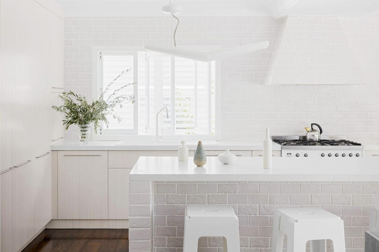 """<p>Though minimalist in style, there's also a decidedly farmhouse-chic vibe going on in this kitchen by <a href=""""https://apdesignhouse.com.au/"""" target=""""_blank"""">AP Design House</a>. The brick got a fresh coat of white paint to brighten it all up and align with the rest of the surfaces and the geometric pendant asserts some modern flair. <a href=""""https://pinterest.com/pin/create/button/?url=https%3A%2F%2Fwww.housebeautiful.com%2Froom-decorating%2Fkitchens%2Fg31133704%2Fmodern-farmhouse-kitchen-ideas%2F&description=Modern%20Meets%20Rustic%20In%20These%20Perfectly%20Balanced%20Farmhouse%20Kitchen&media=https%3A%2F%2Fhips.hearstapps.com%2Fhmg-prod.s3.amazonaws.com%2Fimages%2Fmodern-farmhouse-kitchens-seattle-interior-designer-heidi-caillier-design-dining-room-phinney-ridge-craftsman-home-design-kitchen-inset-shaker-cabinets-bauman-chairs-small-island-industrial-pendant-light-1582833452.jpg%3Fresize%3D1600%3A%2A"""" target=""""_blank""""></a></p>"""