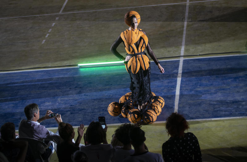 """A model wears a creation from """"Clandestina,"""" the first Cuban independent urban fashion brand, during a launch for the 2020 collection called Sports Glories in Havana, Cuba, Friday, Nov. 22, 2019. (AP Photo/Ramon Espinosa)"""