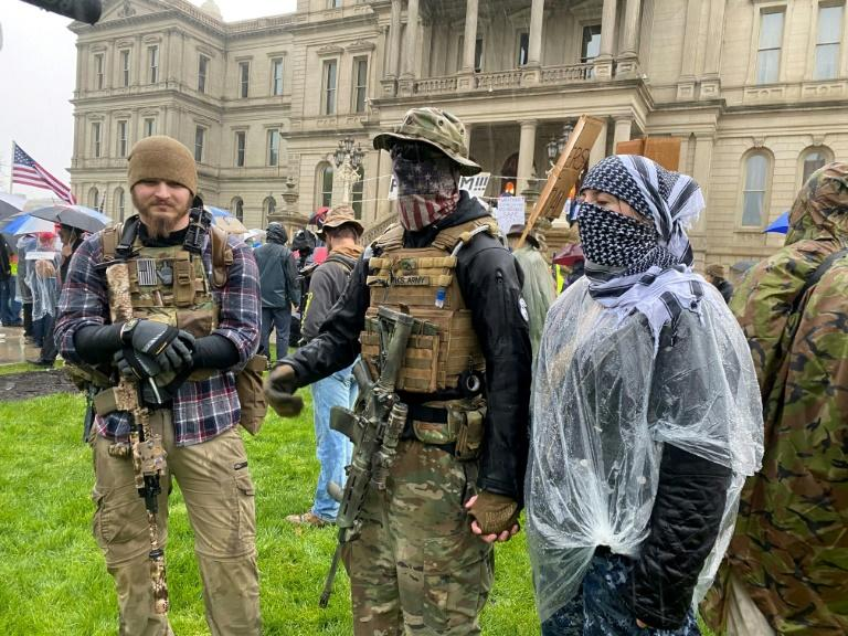 Armed demonstrators protest stay-at-home orders in Lansing, Michigan on May 14, 2020
