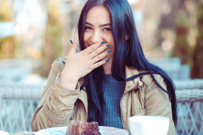 woman laughing to herself anti-jokes
