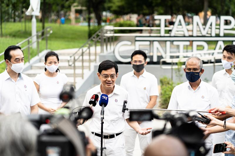 SINGAPORE - JULY 01: Candidate of Prime Ministry of Singapore Heng Swee Keat answers the questions of press members after meeting residents seeking support as the state goes to the polls for general elections in Singapore on July 01, 2020. Officials wore face masks during the campaign as maintaining social distance as a precaution against coronavirus (Covid-19) pandemic. (Photo by Zakaria Zainal/Anadolu Agency via Getty Images)