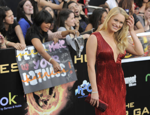 """Actress Leven Rambin arrives at the world premiere of """"The Hunger Games"""" on Monday, March 12, 2012 in Los Angeles. (AP Photo/Chris Pizzello)"""
