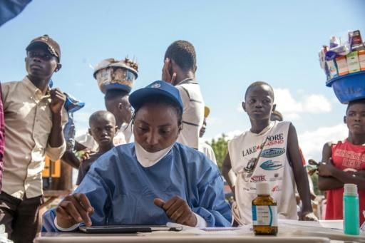 Nurses working with the World Health Organization  prepare to administer vaccines at the town all of Mbandaka