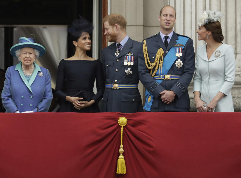 "FILE - In this Tuesday, July 10, 2018 file photo Britain's Queen Elizabeth II, and from left, Meghan the Duchess of Sussex, Prince Harry, Prince William and Kate the Duchess of Cambridge watch a flypast of Royal Air Force aircraft pass over Buckingham Palace in London. In a stunning declaration, Britain's Prince Harry and his wife, Meghan, said they are planning ""to step back"" as senior members of the royal family and ""work to become financially independent."" A statement issued by the couple Wednesday, Jan. 8, 2020 also said they intend to ""balance"" their time between the U.K. and North America. (AP Photo/Matt Dunham, File)"