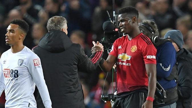 Manajer Manchester United, Ole Gunnar Solskjaer, menganggap Paul Pogba layak menjadi kapten The Red Devils. (AFP/Paul Ellis)