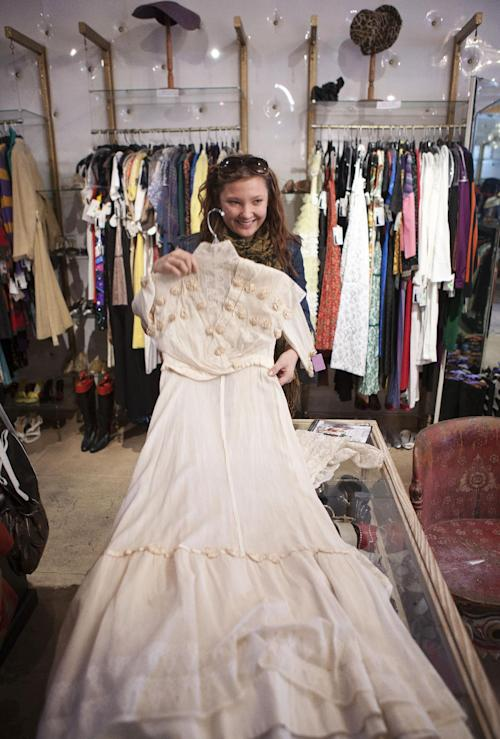 "In this photo taken Thursday, Feb. 21, 2013, Anna Ovdienko looks for a vintage Edwardian era dress at ""The Way We Wore,"" a Hollywood high-end vintage store owned by Doris Raymond in the La Brea District of Los Angeles. Raymond's vintage clothing and accessories store is featured in the reality TV series, ""L.A. Frock Stars,"" which debuts March 7, 2013 on the Smithsonian Channel. (AP Photo/Damian Dovarganes)"