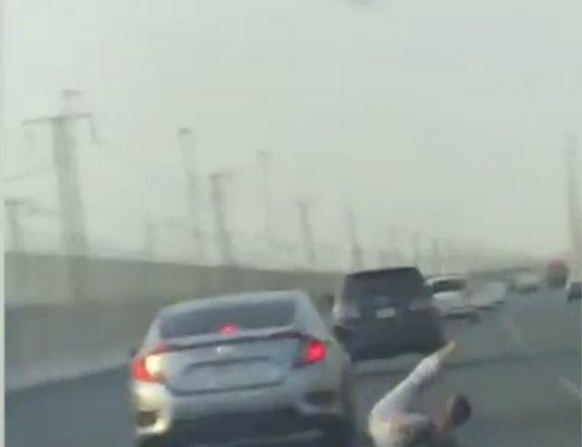 Road rager tumbles out of moving car while trying to slap