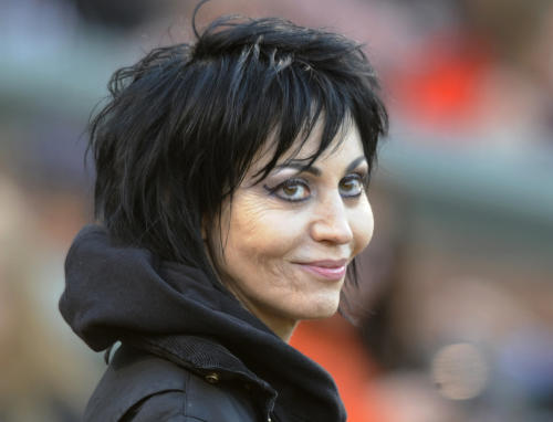 FILE - In this April 20, 2013 file photo, singer and songwriter Joan Jett is seen in Baltimore. Some South Dakota farmers and ranchers are questioning the choice of Jett to grace the state's float in the 2013 Macy's Thanksgiving Day parade. The livestock producers say Jett is a poor choice because she is a vegetarian and supporter of People for the Ethical Treatment of Animals. (AP Photo/Gail Burton, File)