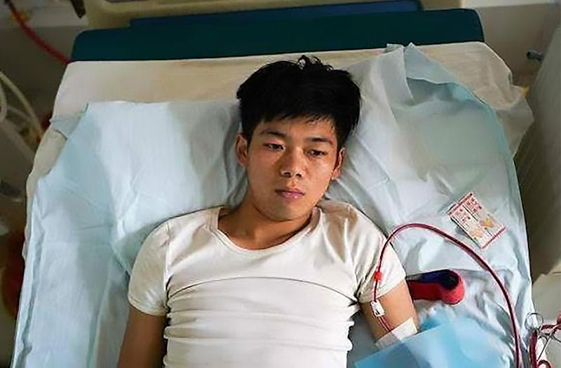 Kidney failure: Wang Shangkun, 25, (pictured) is now bedridden after his remaining kidney failed after he sold his other kidney for organ harvesters aged 17.