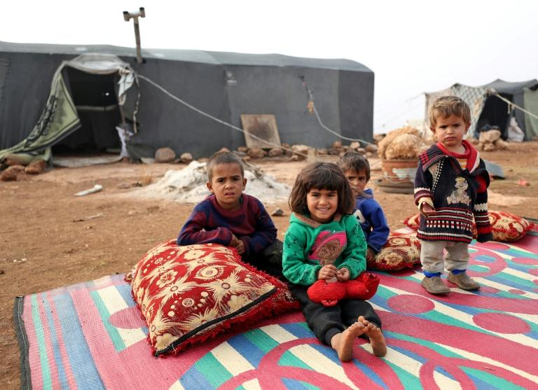 Displaced children in Syria's Idlib province where recent clashes between regime forces and armed groups have killed nearly 70 on both sides