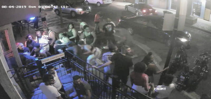 People begin to flee from the sound of gunshots fired by Connor Betts outside a bar in Dayton, Ohio in a CCTV still.