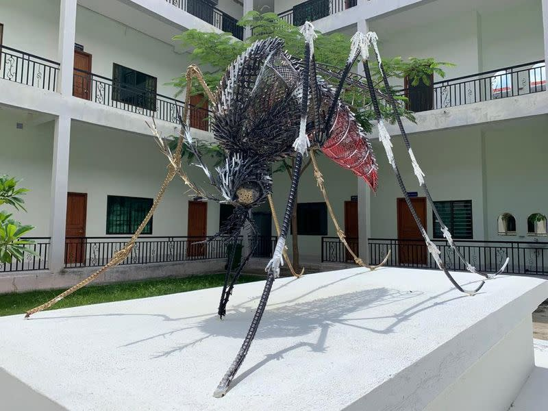 A giant sculpture of a mosquito is pictured in the courtyard of scientist Jessica Manning's lab space, near Phnom Penh