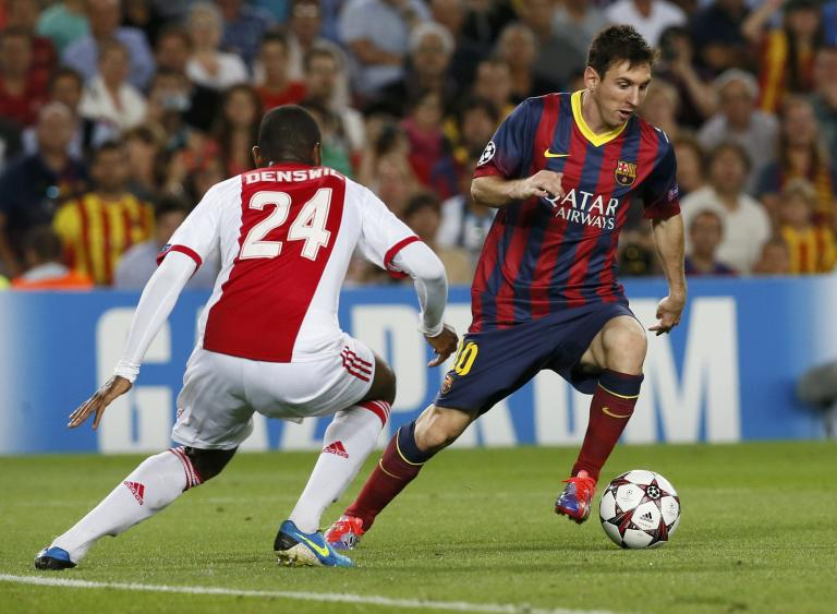 Barcelona's Messi evades Ajax's Denswil before scoring his second goal during their Champions League soccer match at Camp Nou stadium in Barcelona