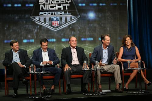 "This publicity image released by NBC shows, from left, Mark Lazarus, Chairman of NBC Sports Group, coordinating producer Fred Gaudelli, Al Michaels, analyst Cris Collinsworth, and sideline reporter Michele Tafoya at the "" Sunday Night Football"" session during the NBCUniversal Press Tour in Beverly Hills, Calif., on Saturday, July 27, 2013. (AP Photo/NBC, Chris Haston)"