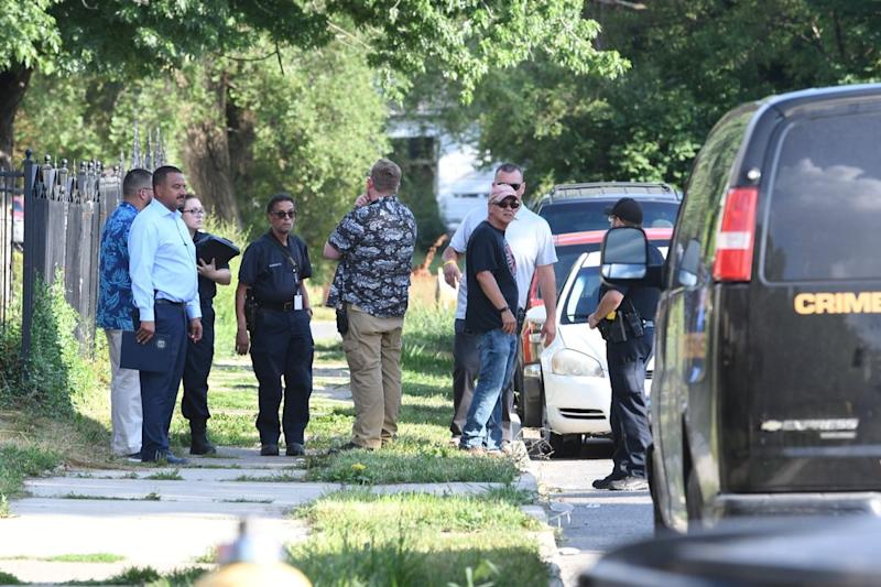 Detroit police respond to the scene where three dogs attacked a young girl who later died of her injuries in Detroit on Monday, Aug. 19, 2019. Police say the owner of three dogs is in custody after the animals killed Emma Hernandez, 9, as she rode a bike. The girl's father, Armando Hernandez, says the man was warned that a fence was too flimsy to hold the dogs. (Max Ortiz/Detroit News via AP)