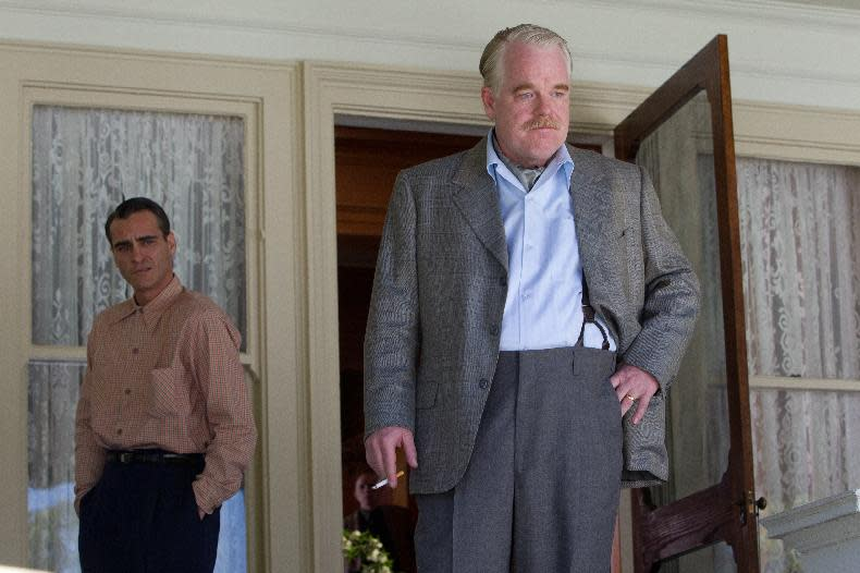 """FILE - This file film image released by The Weinstein Company shows Joaquin Phoenix, left, and Philip Seymour Hoffman in a scene from """"The Master."""" Police say Phillip Seymour Hoffman was found dead in his New York City apartment Sunday, Feb. 2, 2014. He was 46. (AP Photo/The Weinstein Company, File)"""