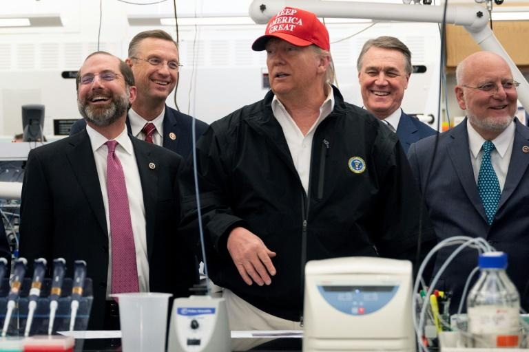 Representative Doug Collins (2L), was with President Donald Trump (C) during a coronavirus briefing at the Centers for Disease Control and Prevention headquarters