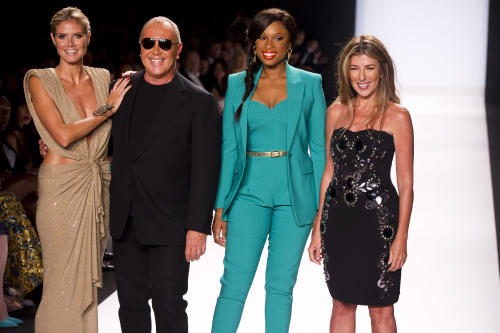 TV host Heidi Klum, from left, designer Michael Kors, singer-actress Jennifer Hudson and Nina Garcia pose on the runway at the Project Runway finale fashion show during Fashion Week on Friday, Sept. 7, 2012 in New York. (Photo by Charles Sykes/Invision/AP Images)