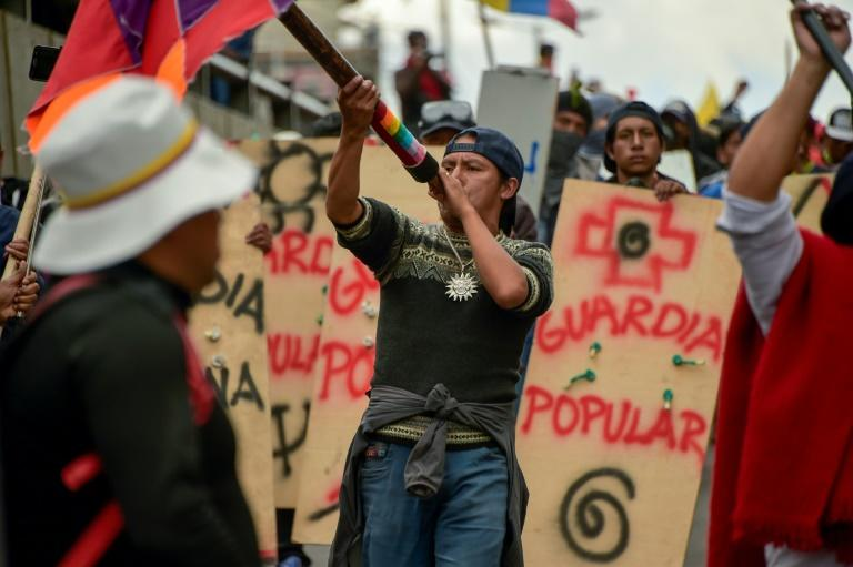 Protesters march against the sharp rise in fuel prices sparked by authorities' decision to scrap subsidies in Quito on October 9, 2019