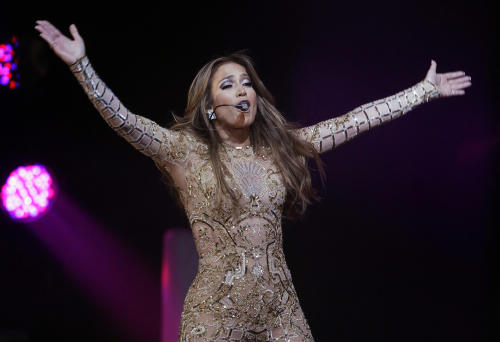 "In a March 23, 2013, file photo Jennifer Lopez performs at the JW Marriott Desert Ridge Resort and Spa in Phoenix. Jennifer Lopez sang ""Happy Birthday"" to the leader of Turkmenistan during a performance DSaturday June 29, 2013, but her representative says had she known there were human rights issues in the country, she wouldn't have performed there at all.(Photo by Rick Scuteri/Invision/AP, file)"