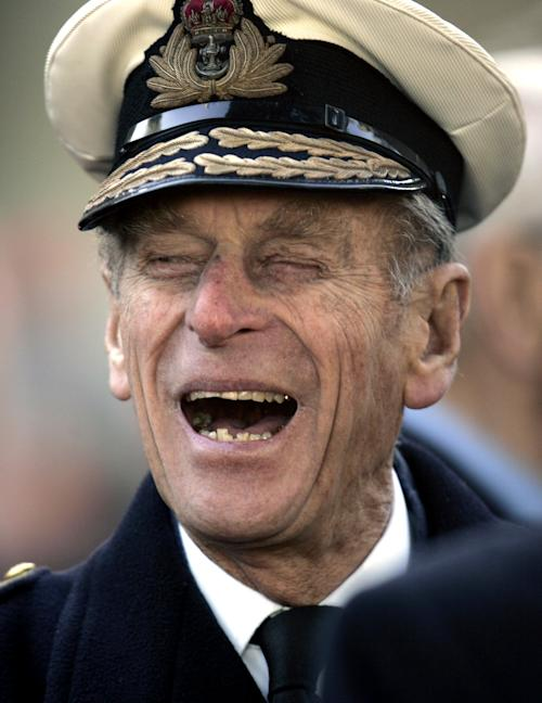 FILE - In this Nov. 9, 2006 file photo Britain's Prince Philip shares a joke with a war veteran, unseen, following a ceremony for the Opening of the Field of Remembrance, on the grounds of the Westminster Abbey, in central London. Buckingham Palace says Prince Philip, husband of Queen Elizabeth II, has been hospitalized with a bladder infection. The 90-year-old prince has been taking part in celebrations of the queen's Diamond Jubilee. (AP Photo/Lefteris Pitarakis, File)