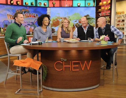 """This Sept. 17, 2013 photo shows the hosts of """"The Chew,"""" from left, Clinton Kelly, Carla Hall, Daphne Oz, Mario Batali and Michael Symon in the studio in New York. When ABC's """"The Chew"""" premiered in September 2011, it begged the question: Was it biting off more than it could chew? Maybe not. On Tuesday in its regular 1 p.m. EST time slot, """"The Chew"""" marks its 500th edition. (AP Photo/ABC, Jeff Neira)"""
