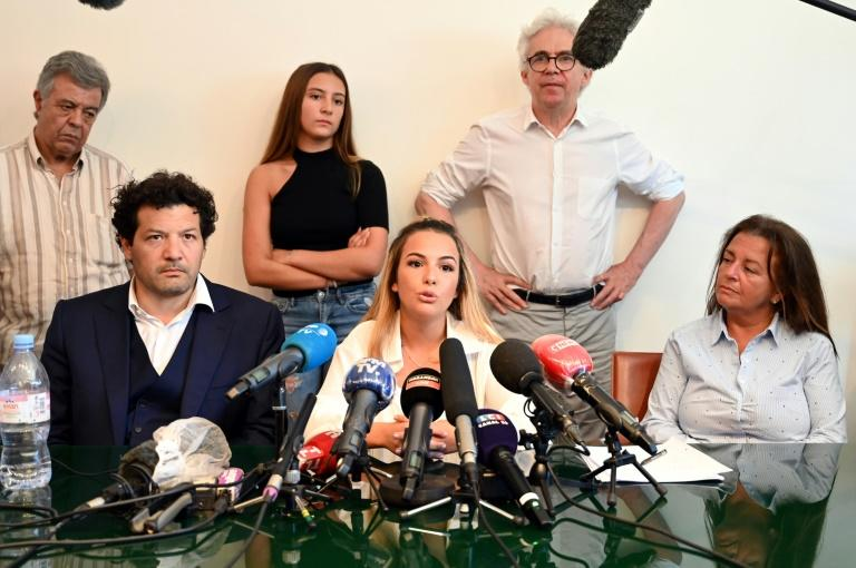 "Sofia Chouviat, centre, daughter of Cedric Chauviat, said Tuesday that ""We don't understand why this chokehold technique still hasn't been banned."""
