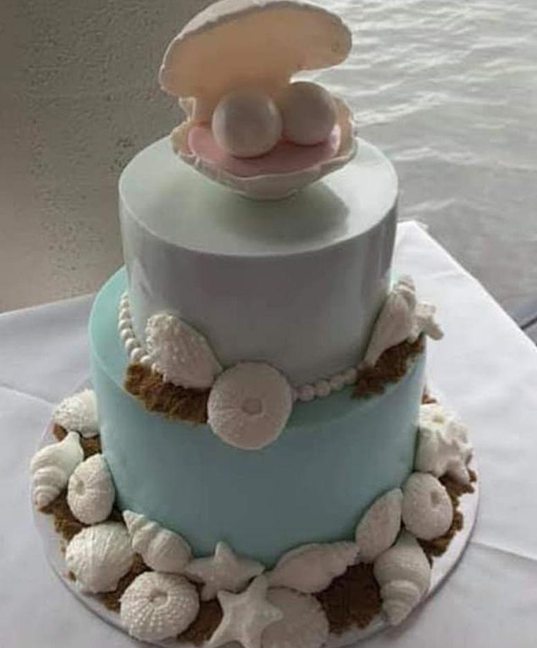 A wedding cake complete with clam shell and two large balls left bride shocked.