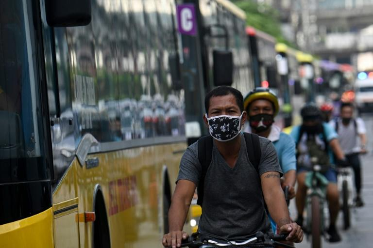 Manila's streets were clogged with traffic Monday as the city's lockdown was lifted