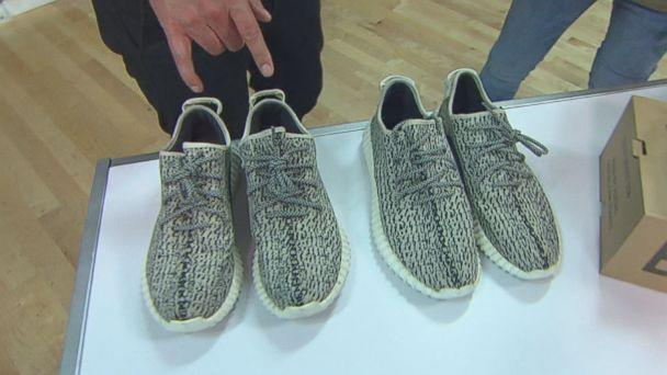Yeezy Busta, an unofficial sneaker authenticator who wears a mask to hide his identity, says the pair of sneakers on the left is fake and the pair on the right is real. (ABC News)