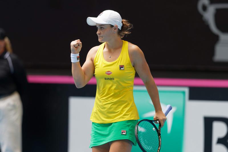 Australia's Ashleigh Barty celebrates defeating France's Caroline Garcia in their Fed Cup tennis final in Perth, Australia, Saturday, Nov. 9, 2019. (AP Photo/Trevor Collens)