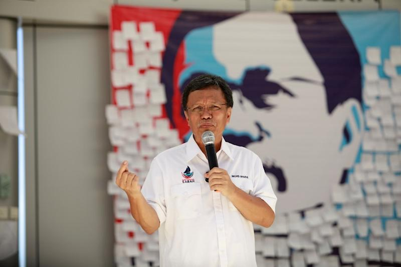 Datuk Seri Shafie Apdal delivers a speech during a ceramah ahead of the Sabah state election. — Picture courtesy of Sabah Chief Minister's Department