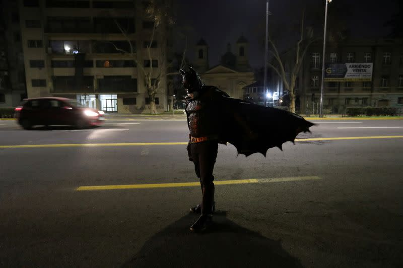 Batman prowls streets of Santiago delivering food to homeless