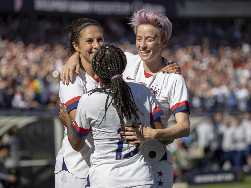 CHICAGO, IL - OCTOBER 06: The United States forward Carli Lloyd (10) reacts after scoring a goal with her teammates the United States forward Megan Rapinoe (15) and the United States defender Crystal Dunn (19) during the five-game Victory Tour between Korea Republic and United States of America on Sunday, October 06, 2019 at Soldier Field in Chicago(Photo by Joseph Weiser/Icon Sportswire via Getty Images)