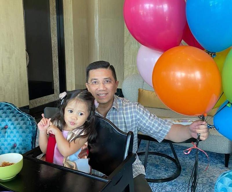 PKR deputy president Datuk Seri Azmin Ali with his birthday grandchild and balloons. — Picture courtesy of twitter.com/AzminAli