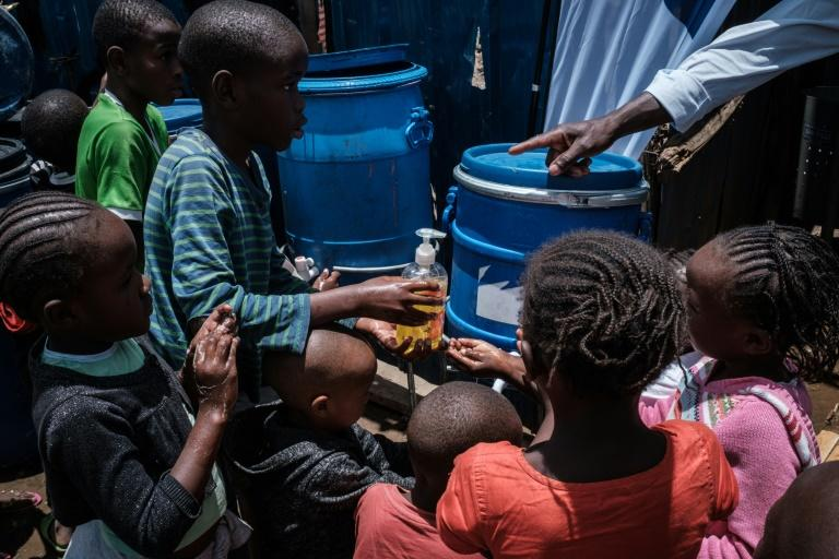 Children in the notorious Nairobia slum of Kibera learn how to wash hands to help prevent coronavirus