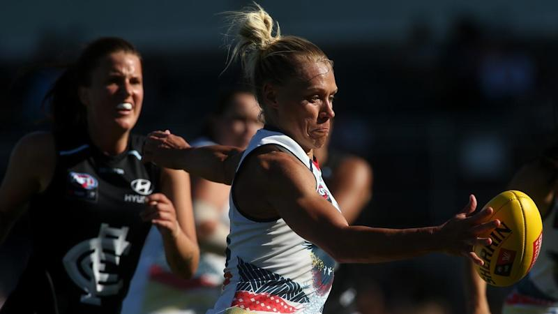 A masterclass by Erin Phillips (C) has led Adelaide to a hard-fought AFLW win over Carlton