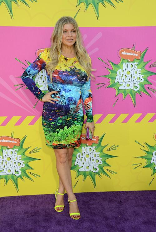 FILE - This March 23, 2013 singer Fergie, pregnant with her first child, arrives at the 26th annual Nickelodeon's Kids' Choice Awards in Los Angeles. Fashion experts say a streamlined style best suits a baby bump. (Photo by Jordan Strauss/Invision/AP)