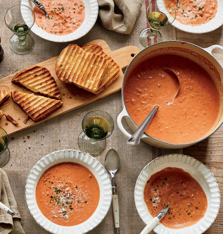 """<p>Skip the heavy cream to keep this soup, from Ina Garten's twelfth cookbook, <em><a href=""""https://www.amazon.com/Modern-Comfort-Food-Barefoot-Contessa/dp/0804187061/ref=sr_1_2?tag=countryliving_auto-append-20&ascsubtag=[artid 10050.r.33588147[src [ch [lt """" target=""""_blank"""">Modern Comfort Food</a></em>, healthier (and almost as delicious). Pair with her <a href=""""https://www.countryliving.com/food-drinks/a33588339/ina-garten-grilled-cheese-sandwiches/"""" target=""""_blank"""">Cheddar & Chutney Grilled Cheese Sandwiches</a> for the perfect weeknight dinner.</p><p><strong><a href=""""https://www.countryliving.com/food-drinks/a33588147/ina-gartens-creamy-tomato-bisque/"""" target=""""_blank"""">Get the recipe</a>.</strong></p><p><strong><a class=""""body-btn-link"""" href=""""https://www.amazon.com/Tramontina-80131-035DS-Enameled-5-5-Quart/dp/B077BHPZGC/?tag=syn-yahoo-20&ascsubtag=%5Bartid%7C10050.g.1658%5Bsrc%7Cyahoo-us"""" target=""""_blank"""">SHOP DUTCH OVENS</a></strong></p>"""