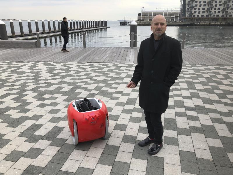 Piaggio Fast Forward co-founder Jeffrey Schnapp talks about his company's cargo-carrying robot called the Gita on Monday, Nov. 11, 2019, in Boston. The machine uses cameras and sensors to follow its owner carrying groceries and other items. (AP Photo/Matt O'Brien)