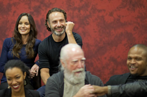 "Andrew Lincoln, top right, who plays Rick Grimes on the cable TV show ""The Walking Dead,"" sits for a photo with fellow cast members at Walker Stalker Con, a convention based off the show, Saturday, Nov. 2, 2013, in Atlanta. For Lincoln, acting out the battle scenes in downtown Atlanta during the first season of ""The Walking Dead"" was a joyous time. Here was the British actor, on the same streets where Confederate forces battled Union troops in the American Civil War, shooting his way through a foreboding urban landscape now over-run by flesh-devouring ""walkers."" ""It was one of the greatest weekends of my career, you know,"" he says, his eyes lighting up with excitement. ""We shut down four blocks of downtown Atlanta and I get to ride into the city on a horse. It was epic. (AP Photo/David Goldman)"