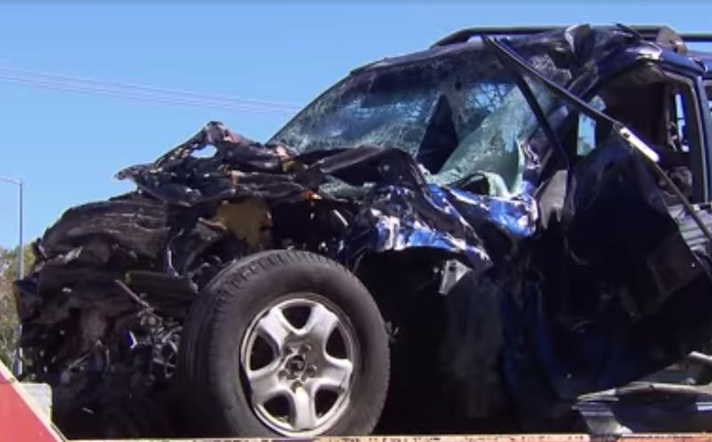 A man and a boy were killed in a Darwin crash. Pictured is one of the smashed up cars involved.
