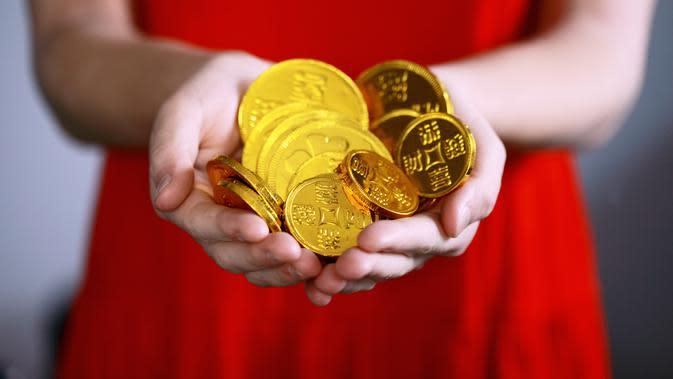 Golden Coin (unsplash.com/Sharon Mccutcheo)
