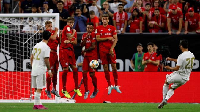 Real Madrid menelan kekalahan 1-3 dari Bayern Munchen pada turnamen pramusim, International Champions Cup 2019, di NRG Stadium, Houston, Minggu (21/7/2019) pagi WIB. (AFP/AARON M. SPRECHER)